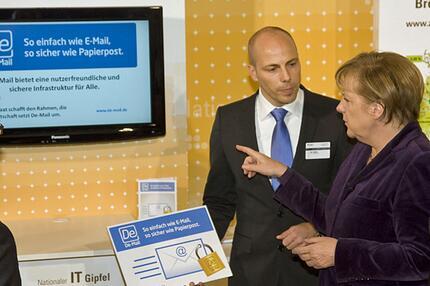 Jan Oetjen und Angela Merkel