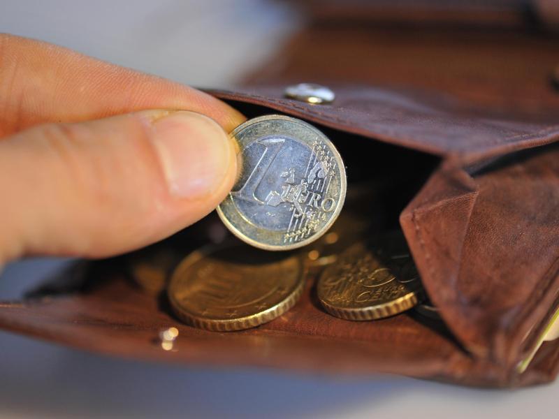 Bild zu Geldbörse mit Münzen