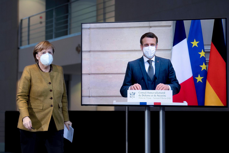 """Bild zu Emanuel Macron und Angela Merkel wollen in der Ostukraine """"deeskalieren""""."""