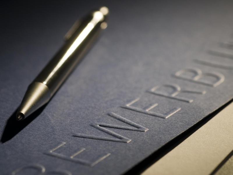 Bild zu Stift und Bewerbungsmappe