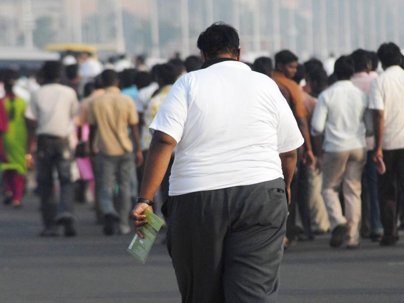 Bild zu Übergewichter Mensch