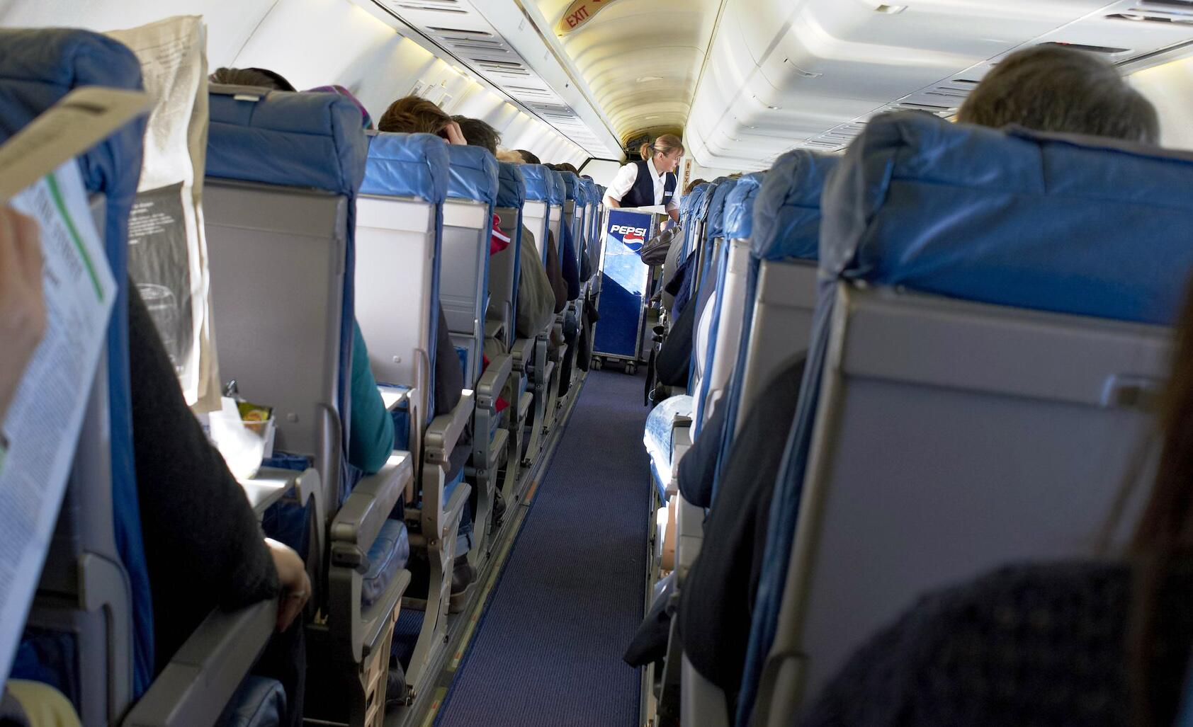 Bild zu Passagiere im Flugzeug
