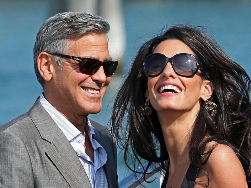 Bild zu Amal und George Clooney