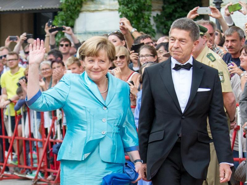 Bild zu Angela Merkel & Joachim Sauer