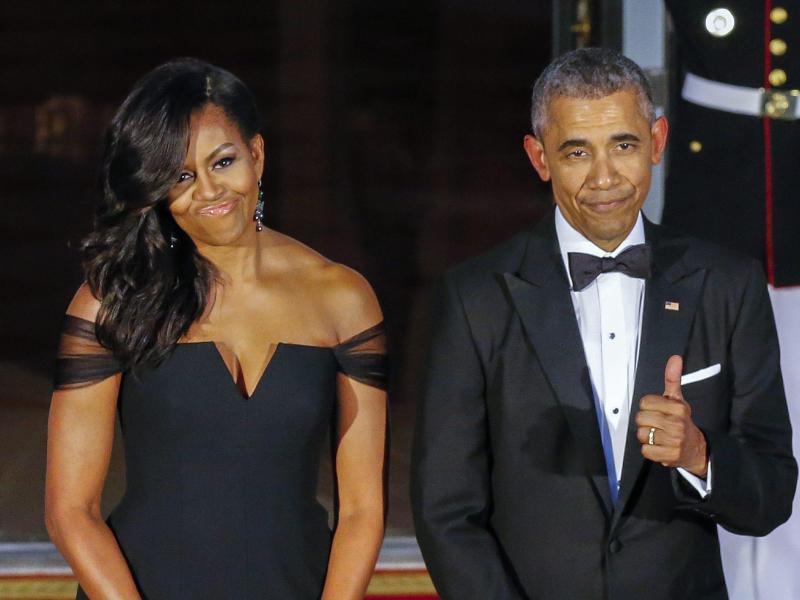 Bild zu Barack & Michelle Obama