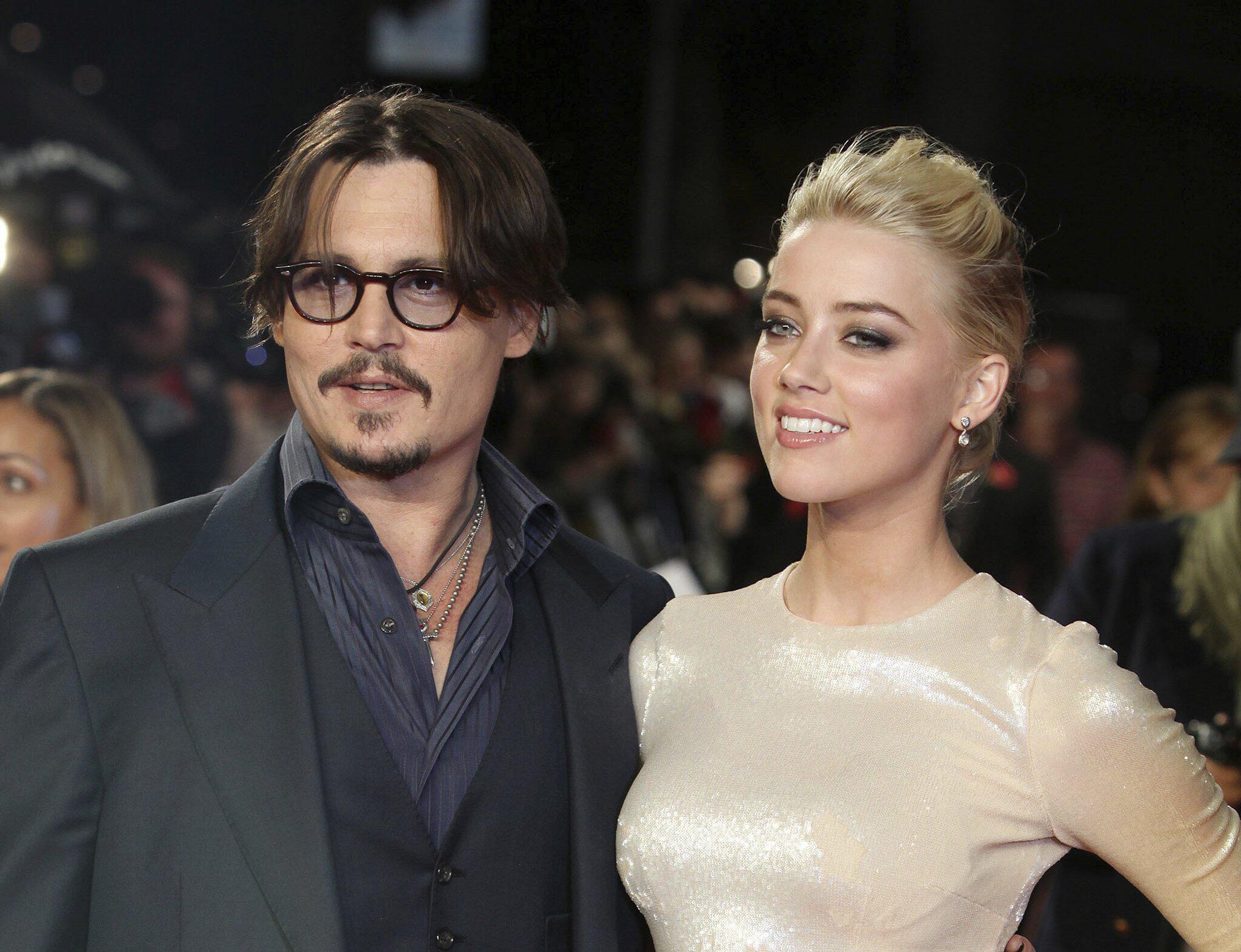 Bild zu Johnny Depp und Amber Heard