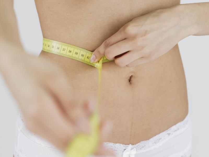Bild zu Bauch und Maßband
